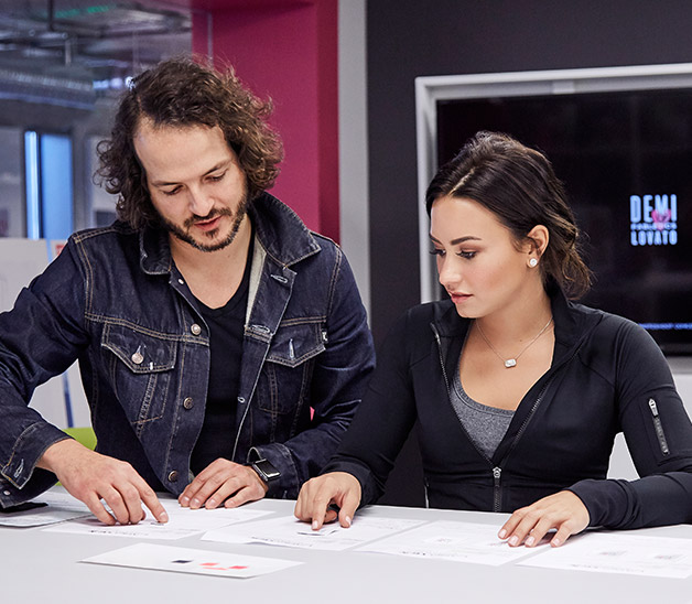 Demi Lovato at Fabletics designing outfits