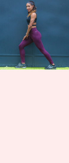 A woman stretching in running clothes.