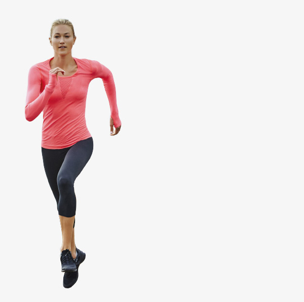 A woman running in a pink top and capris.