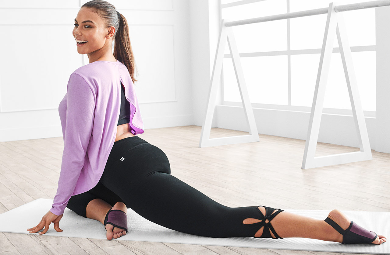 Model wearing Fabletics Plus Size Sportswear