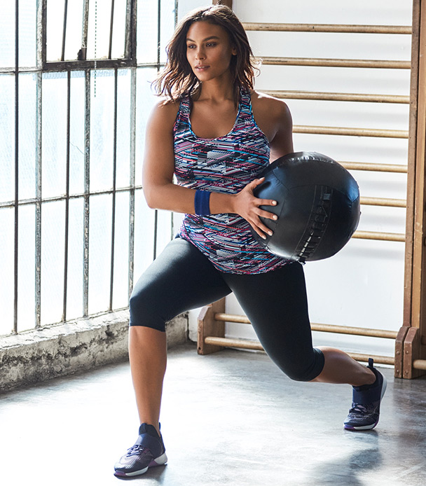 Plus size model with medicine ball