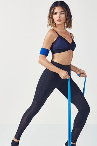 Model wearing Fabletics and working out